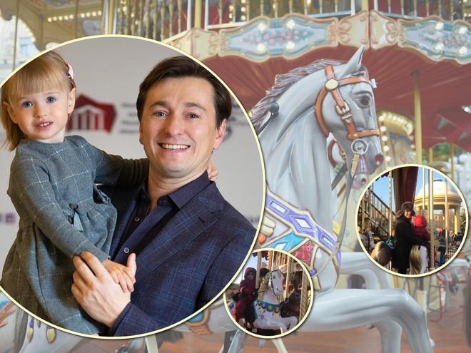 Чудо-папа: Сергей Безруков покатал дочь на карусели